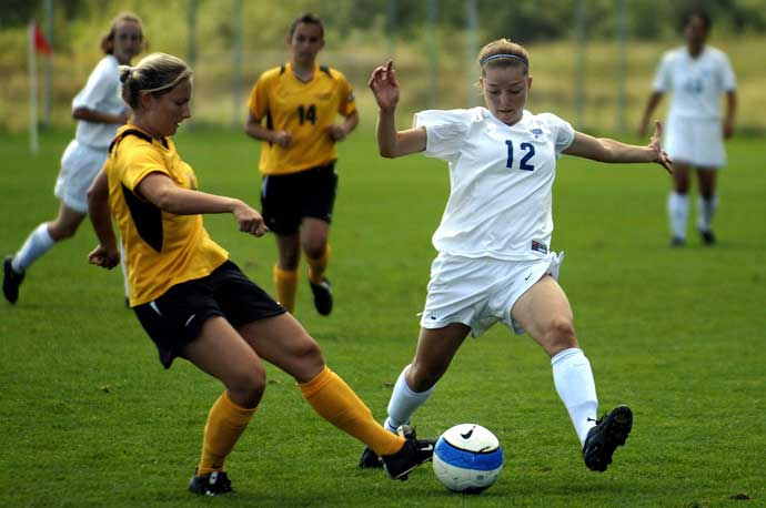 Female Soccer players in action